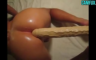 Enormous Dildo In Oiled Shemale Ass